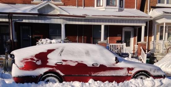 Saab 9-3 half buried in snow bank